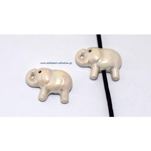 Κομψό κεραμικό ελεφαντάκι 28X16mm με διαμπερη τρύπα για κορδόνι 2mm σε λευκό γυαλιστερό     τιμή ανα τεμάχιο